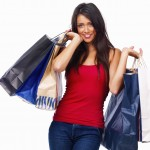 Closeup of a girl holding shopping bags isolated on white