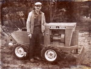 This isn't my dad, but was in his Ditch Witch photo album. I bet this guy was The Sage of Ditch Witch - imparting wisdom to young franchisees.